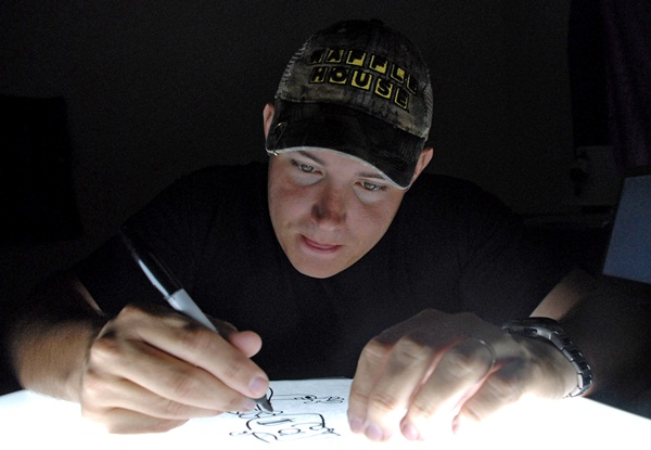 Air Force cartoonist publishes book while deployed